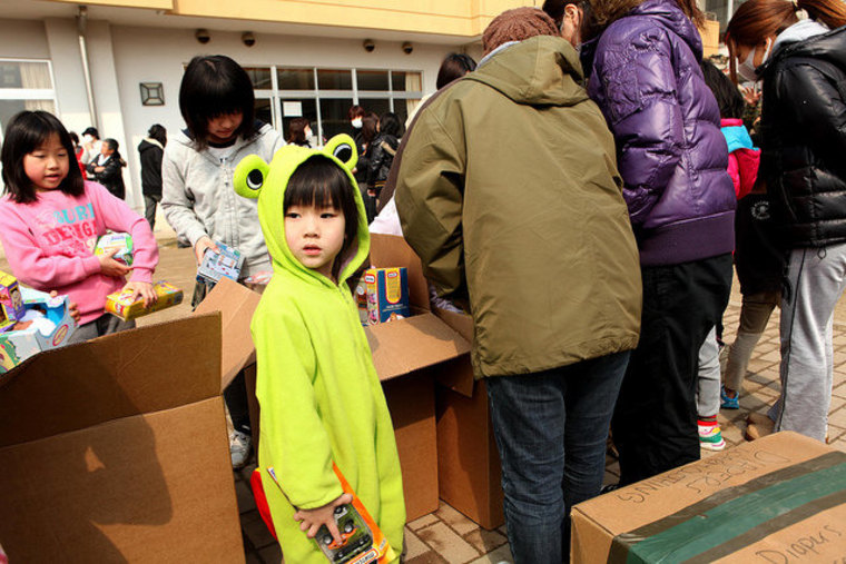 Kids in Okuma, Japan, get toys back in March from a combined U.S. and Japanese military help center.