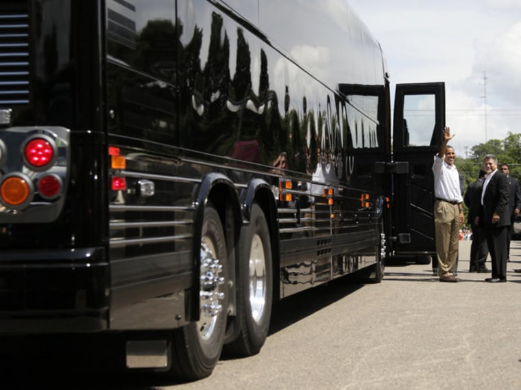 President Obama waves from his bus on Monday, during a three-day tour of the Midwest.