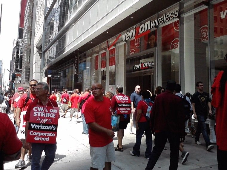 Verizon workers picketing outside a Verizon Wireless store  in Manhattan