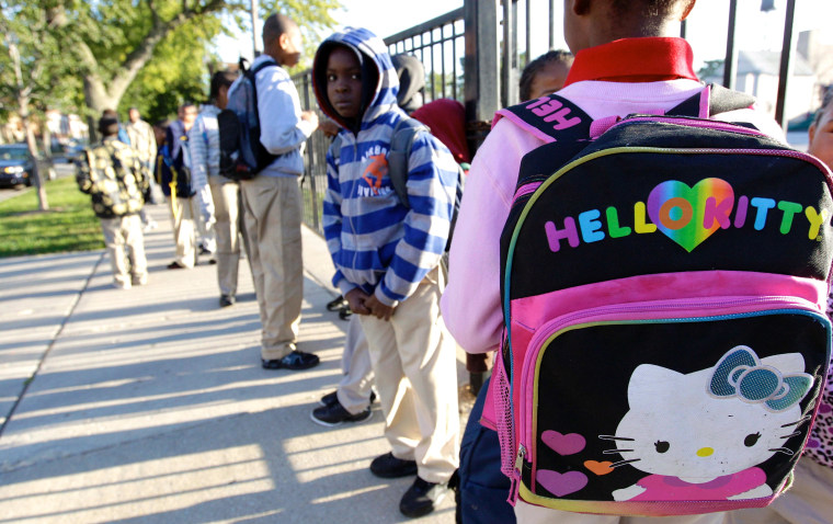 Students gather outside Benjamin E. Mays Academy in Chicago for the first day of school Wednesday morning, after Chicago teachers voted to suspend their first strike in 25 years.