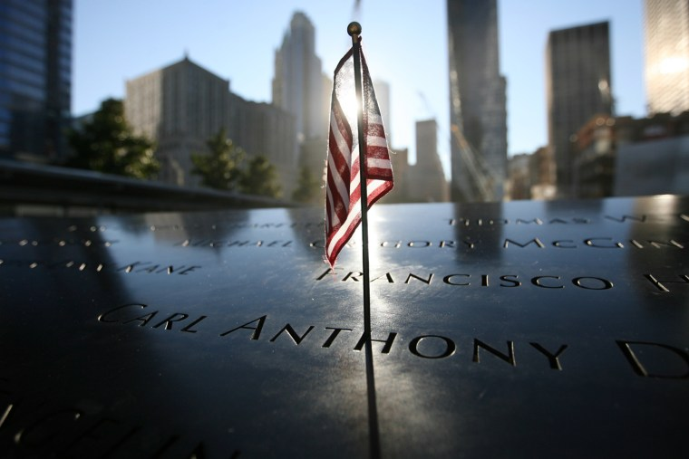 A small US flag stands at September 11 memorial during observances on the eleventh anniversary of the attacks on the World Trade Center, on September 11, 2012 in New York.