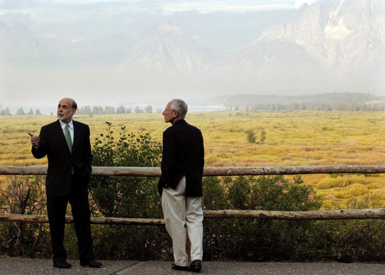 Federal Reserve Chairman Ben Bernanke, left, and Stanley Fischer, right, Governor of the Bank of Israel, talk together outside the Jackson Hole Economic Symposium on Friday.
