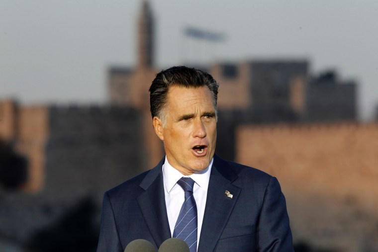 Mitt Romney, sporting a double USA-Israel flag pin, delivers a speech yesterday in Jerusalem.