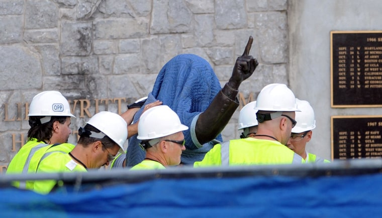 The statue of the late Joe Paterno at Penn State's Beaver Stadium was removed early yesterday. Today, crippling NCAA sanctions were levied upon the football program.