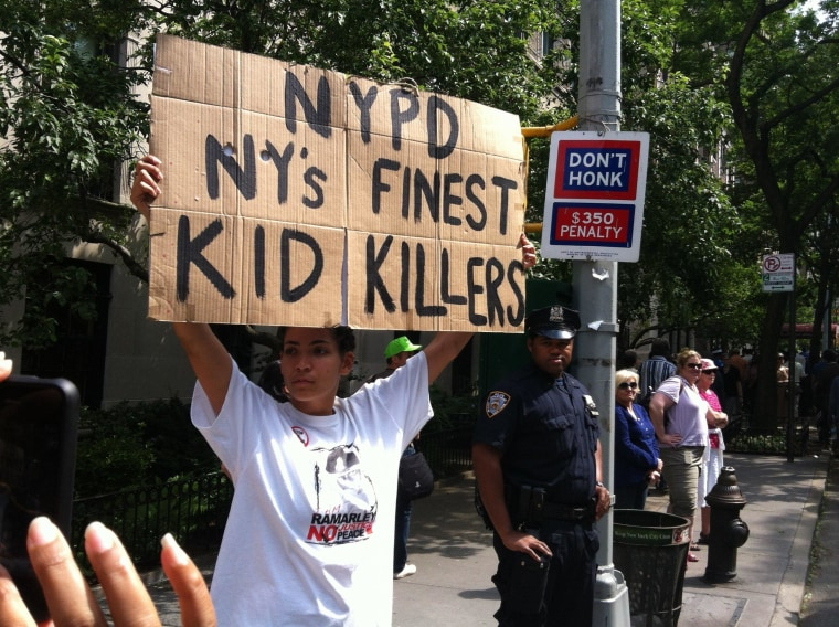 In front of an officer, a protester voices her displeasure with the New York Police Department during a June silent march down New York's Fifth Avenue.