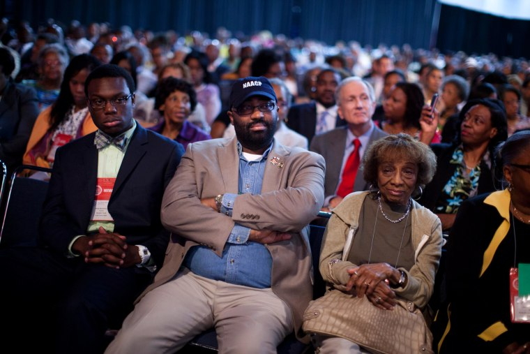N. Scott Phillips, of Baltimore, Md., listens to Republican presidential candidate Mitt Romney deliver a speech during the NAACP annual convention Wednesday in Houston, Texas.