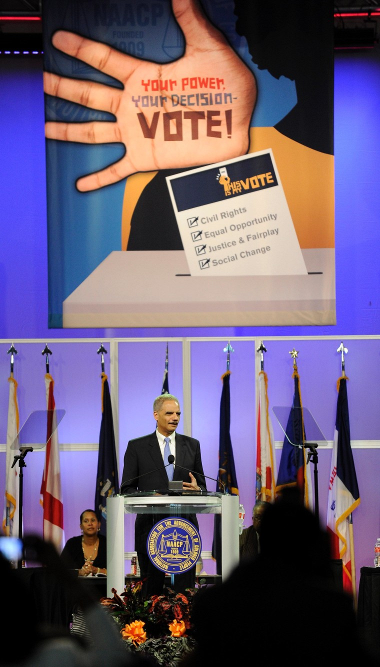 Attorney General Eric Holder addresses the NAACP on Tuesday.