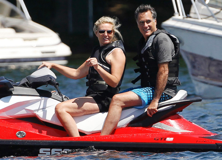 Presumptive Republican presidential nominee Mitt Romney rides a jet ski with his wife on Monday.