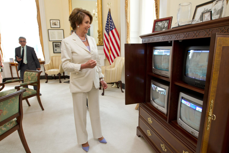 """House Minority Leader Nancy Pelosi, wearing her """"lucky purple pumps"""" as she learns about yesterday's health care ruling. Rep. Pelosi will be Melissa's guest on Saturday morning."""