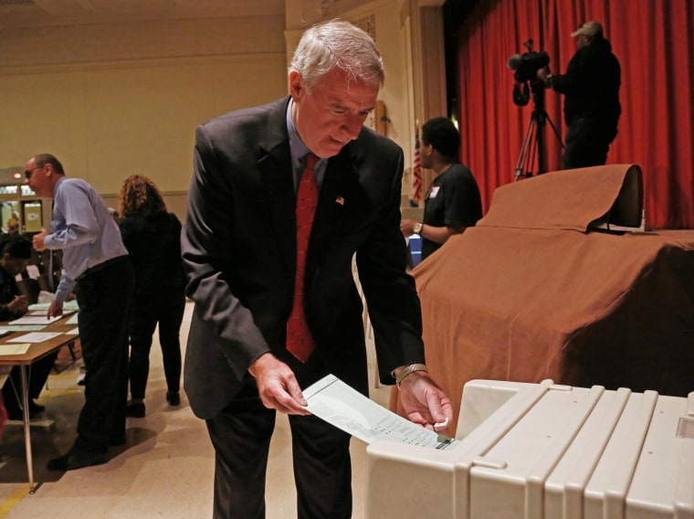 Tom Barrett, the man who would replace Governor Scott Walker if he is recalled today, puts in his ballot this morning.