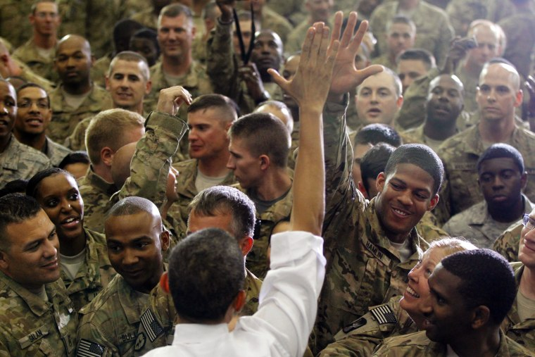 President Obama high-fives a soldier in Afghanistan yesterday.