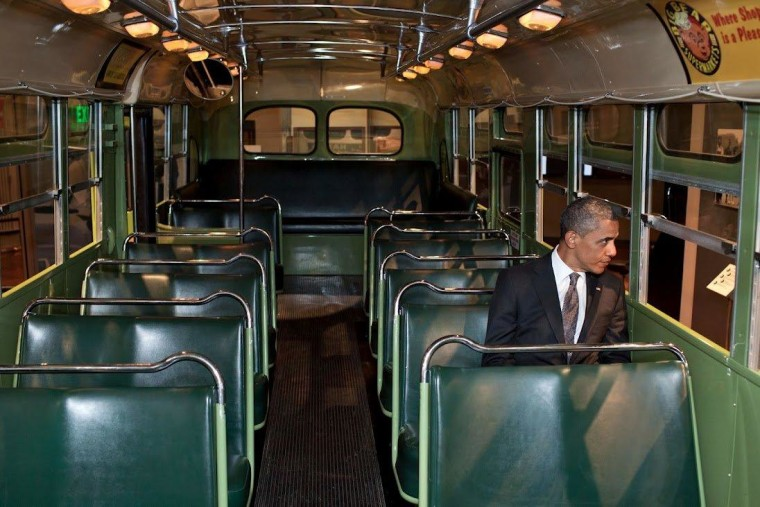 President Obama sits at the front of the bus