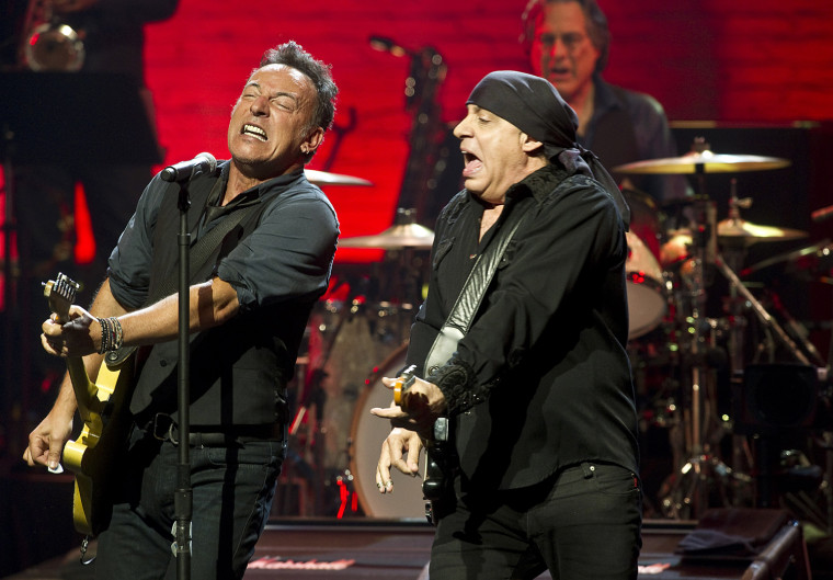 Bruce Springsteen (L) and Steven Van Zandt perform at The Apollo Theater on March 9, 2012