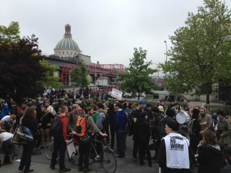 May Day protesters gather near the Williamsburg Bridge on Tuesday, May 1, 2012 in New York City