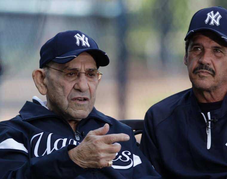 New York Yankees Hall of Fame catcher and special advisor Yogi Berra, left, sits beside former pitcher and spring guest instructor Ron Guidry during an interview before the Yankees spring training baseball game against the Washington Nationals at...