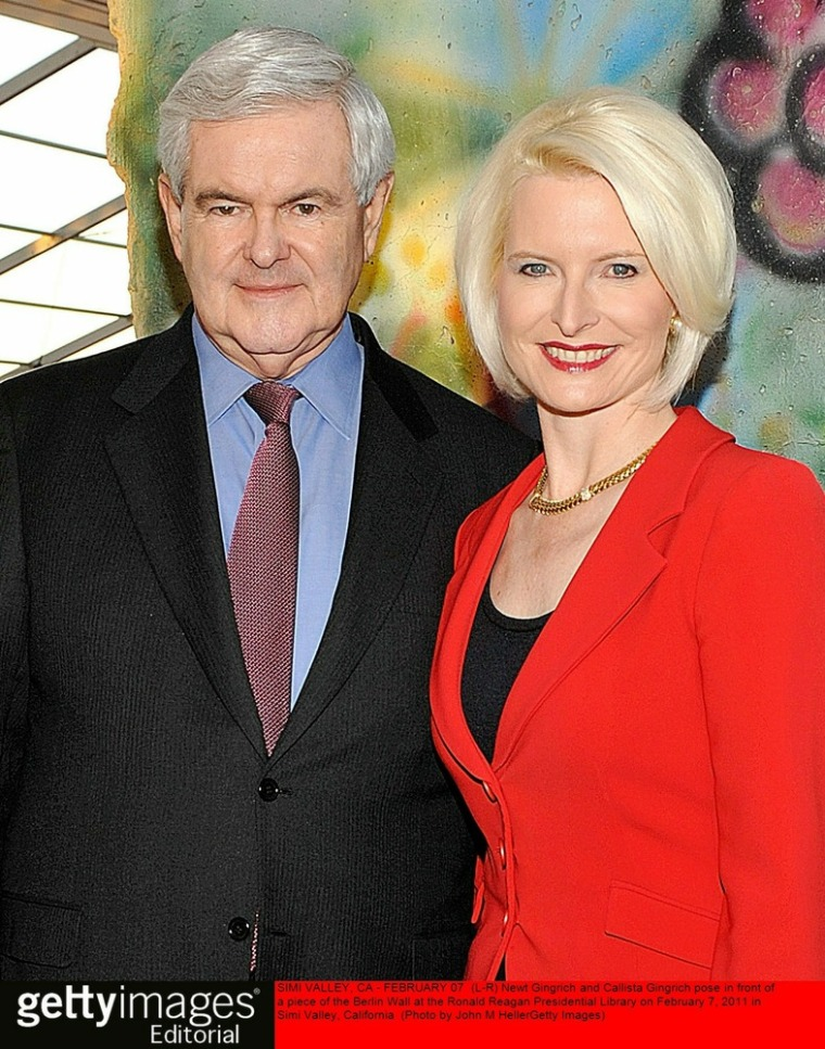 SIMI VALLEY, CA - FEBRUARY 07:  (L-R) Newt Gingrich and Callista Gingrich pose in front of a piece of the Berlin Wall at the Ronald Reagan Presidential Library on February 7, 2011 in Simi Valley, California.  (Photo by John M. Heller/Getty Images)