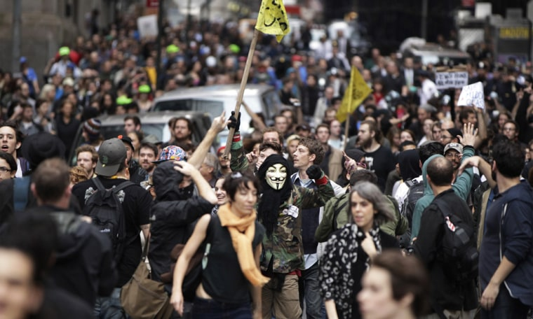 Members of the Occupy Wall Street movement march through the financial district of New York October 14, 2011.