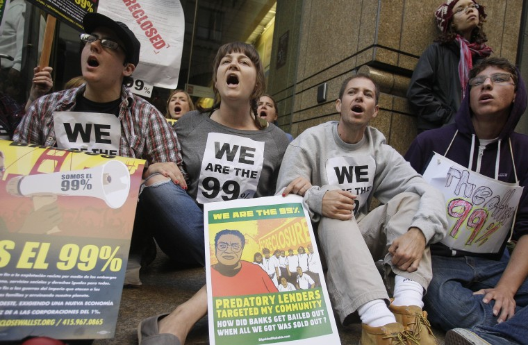 Protesters block an entry way to a Wells Fargo bank in San Francisco, Wednesday, Oct. 12, 2011. Eleven people were arrested Wednesday during an anti-Wall Street rally in front of Wells Fargo Bank headquarters in downtown San Francisco, police said.