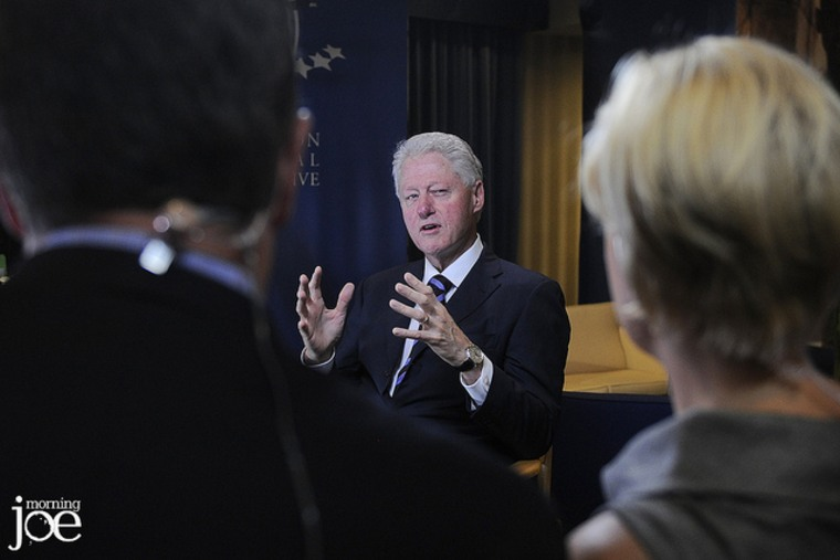 Former President Bill Clinton talks with Joe Scarborough and Mika Brzezinski during the Clinton Global Initiative in Manhattan.