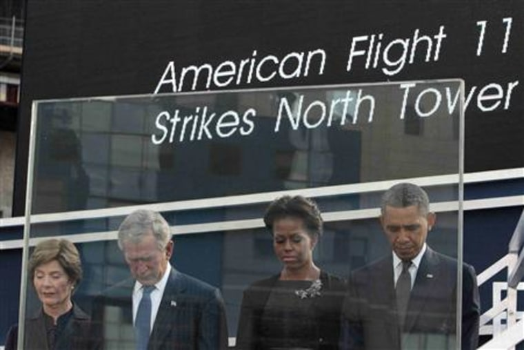 (left to right) Laura Bush, former president George W. Bush, Michelle Obama and President Barack Obama bow their heads during a moment of silence during ceremonies marking the 10th anniversary of the 9/11 attacks on the World Trade Center, in New York,...