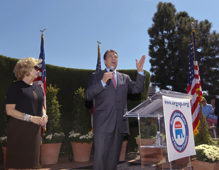 Republican presidential candidate Texas Gov. Rick Perry, right, speaks as his wife Anita looks on during a Republican Party of Orange County rally at Roger's Gardens in Newport Beach, Calif., Thursday, Sept. 8, 2011.