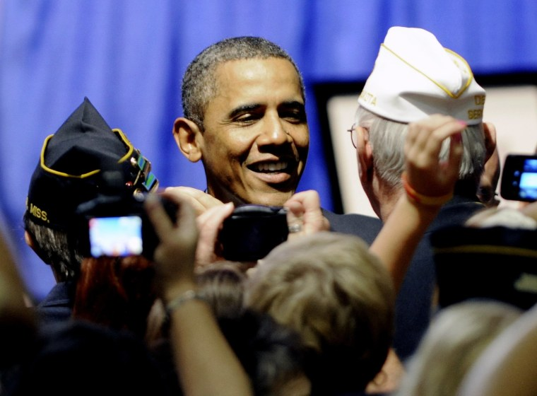 President Barack Obama greets veterans after he addressed the national convention of the American Legion, Tuesday, Aug. 30, 2011, in Minneapolis.