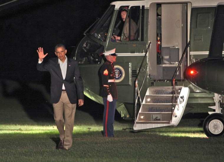 President Barack Obama arrives on the South Lawn of the White House following a three day bus tour through Minnesota, Iowa and Illinois.