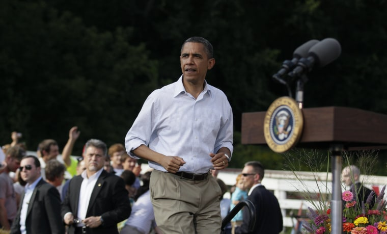 President Barack Obama arrives to speak during a town hall meeting, Monday, Aug. 15, 2011, at the Seed Savers Exchange in Decorah, Iowa, during his three-day economic bus tour.