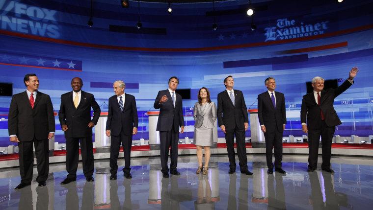 Republican presidential candidates from left, former Pennsylvania Sen. Rick Santorum; businessman Herman Cain; Rep. Ron Paul, R-Texas, former Massachusetts Gov. Mitt Romney; Rep. Michele Bachmann, R-Minn.; former Minnesota Governor Tim Pawlenty; former...