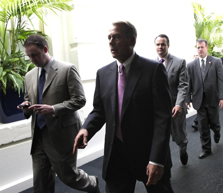 Speaker of the House John Boehner walks through a basement corridor in the Capitol after an afternoon caucus with House Republicans seeking an agreement on legislation to raise the nation's debt limit, in Washington, Wednesday, July 27, 2011.