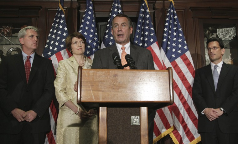 House Speaker John Boehner of Ohio, at podium, accompanied by members of the House Republican leadership, speaks during a news conference at The Republican National Committee on Capitol Hill in Washington, Tuesday, July 26, 2011. From left are, House...