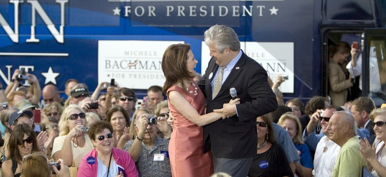 Republican presidential candidate Michele Bachmann, R-Minn., dances with her husband Marcus Bachmann outside of Ripley's Aquarium in Myrtle Beach, S.C. Tuesday, June 28, 2011.