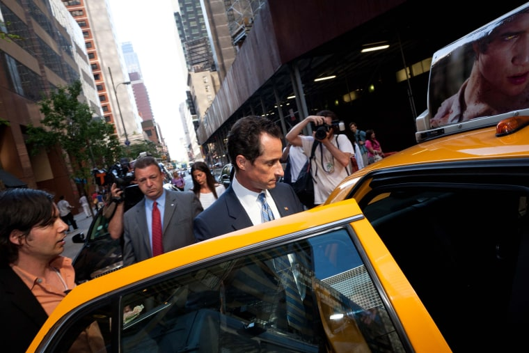 """Democratic Rep. Anthony Weiner leaves a press conference where he confessed that he tweeted a sexual photo of himself to a young woman and admitted to """"inappropriate"""" exchanges with six women before and after getting married at a press conference in..."""