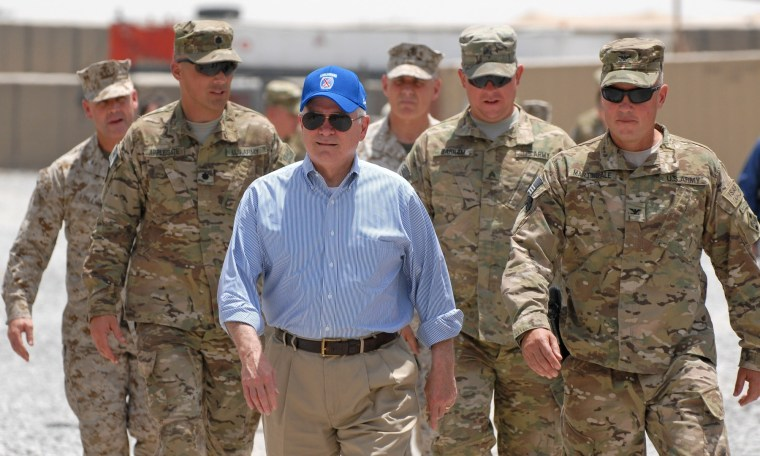 In this photo provided by ISAF Regional Command (South), U.S. Secretary of Defense Robert M. Gates walks with a group of service members at Forward Operating Base Walton, Sunday, June 5, 2011, in Kandahar, Afghanistan.