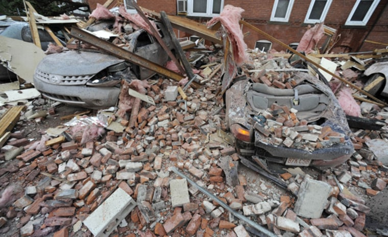 Bricks and debris that fell from a building lay on top of cars after a report of a tornado in Springfield, Mass., Wednesday, June 1, 2011. An apparent tornado struck downtown Springfield, one of Massachusetts' largest cities, scattering debris,...