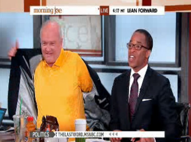 Barnicle shows off his electric yellow shirt. Capehart isn't impressed.