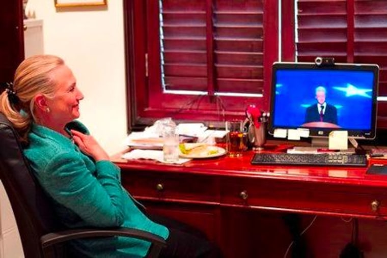 Secretary of State Hillary Clinton watching her husband address the DNC Wednesday evening from the residence of the U.S. Ambassador to Timor Leste in Asia.