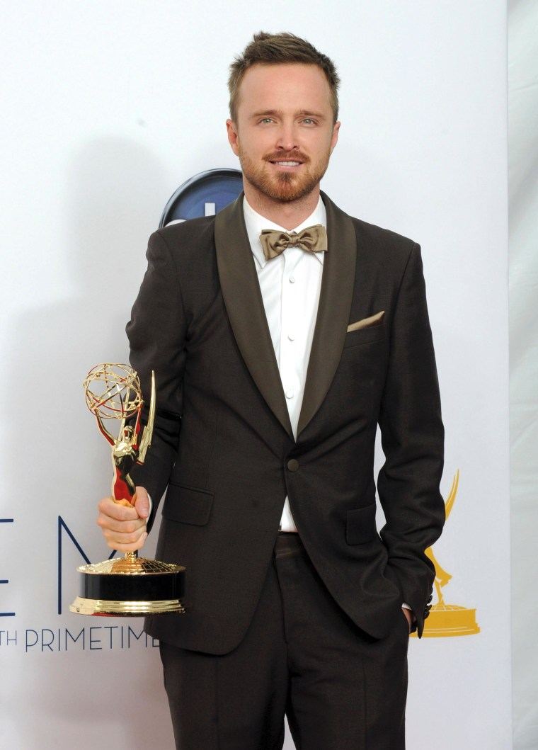 """Actor Aaron Paul, winner of the award for Outstanding Supporting Actor In A Drama Series for \""""Breaking Bad,\"""" poses backstage at the 64th Primetime Emmy Awards at the Nokia Theatre on Sunday, Sept. 23, 2012, in Los Angeles."""