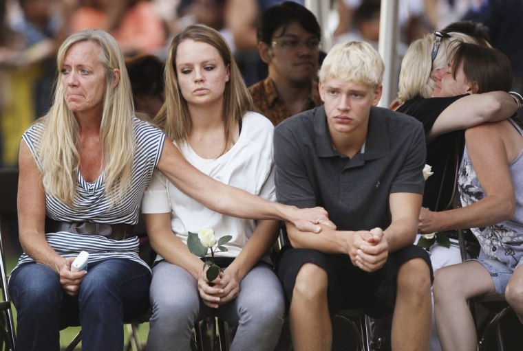 Family members of victims killed in  Friday's Century 16 movie theater shootings grieve at a prayer vigil in Aurora, Colo., on Sunday night.