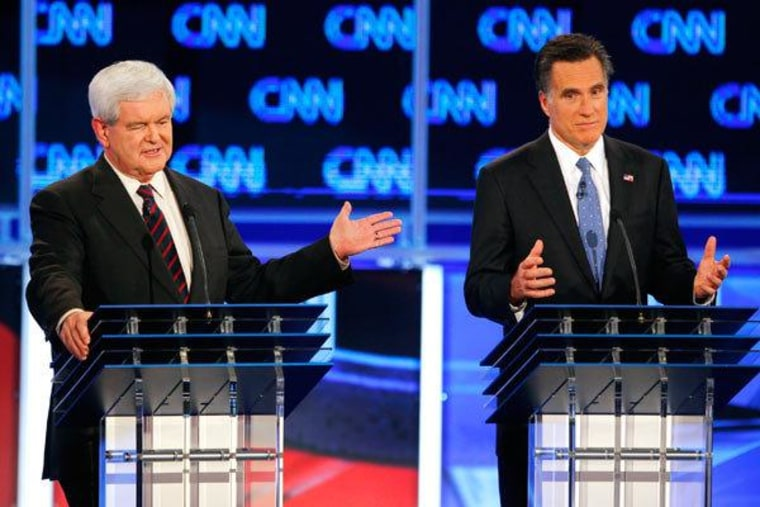 Frenemies Newt Gingrich and Mitt Romney facing off at Republican primary debate in Jacksonville, Florida on January 26, 2012.