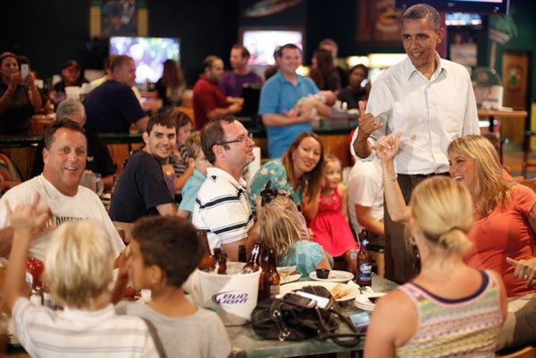 President Obama chatting with seven-year-old Andre Wupperman on Saturday in Orlando, Florida.