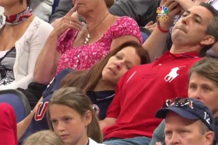 Ricky and Lynn Raisman watching their daughter, Aly, compete at the 2012 Summer Olympics in London on Sunday.