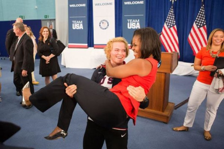 Olympian hoists Michelle Obama