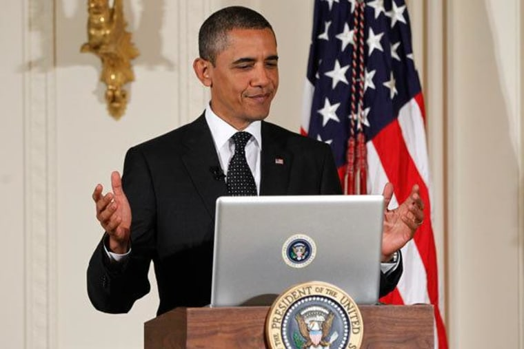 """President Obama tweeting during a """"Twitter Town Hall"""" at the White House in July 2011."""