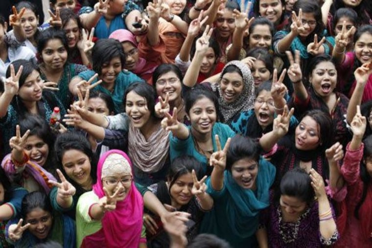 Women and girls celebrating after the announcement that girls outperformed boys on top school exams in Bangladesh.