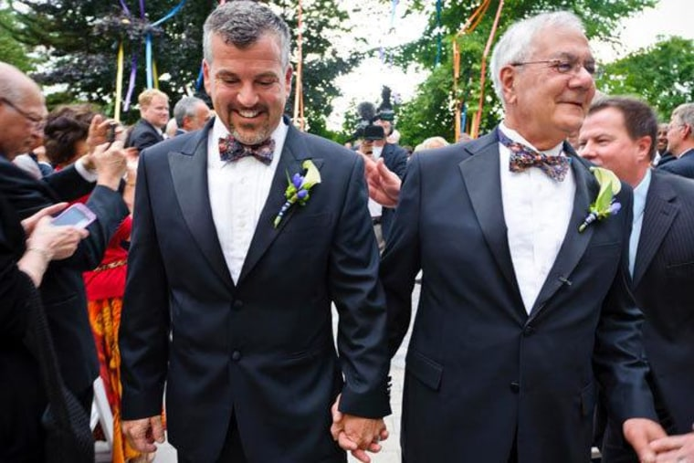 Rep. Barney Frank and Jim Ready walking back down the aisle after exchanging vows in Newton, Massachusetts on Saturday.