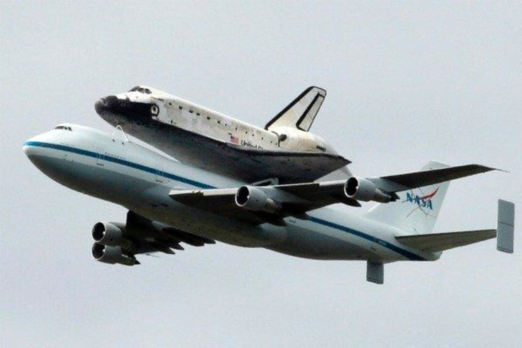 Space shuttle Discovery flying over the National Mall in Washington, D.C. on Tuesday.