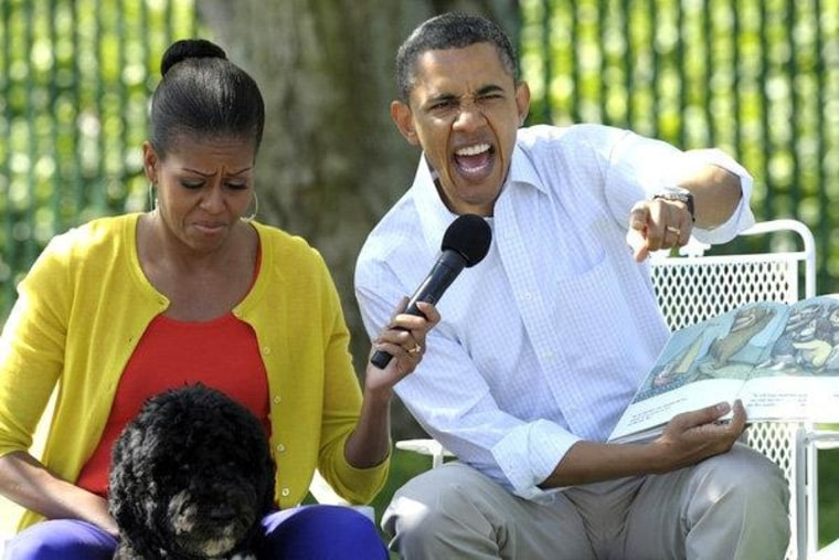 The Obamas during a very dramatic story time on Sunday.