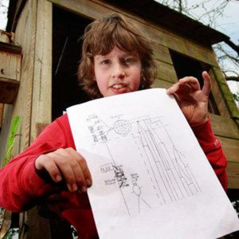 Jurre Hermans poses with the drawing he submitted at his home in the Netherlands on Tuesday.
