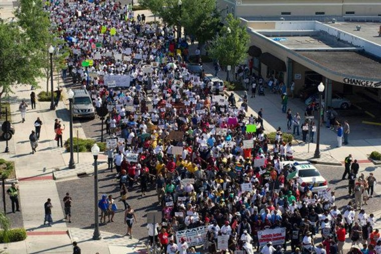Thousands of people marching through the streets of Sanford, Florida in support of Trayvon Martin on Monday.